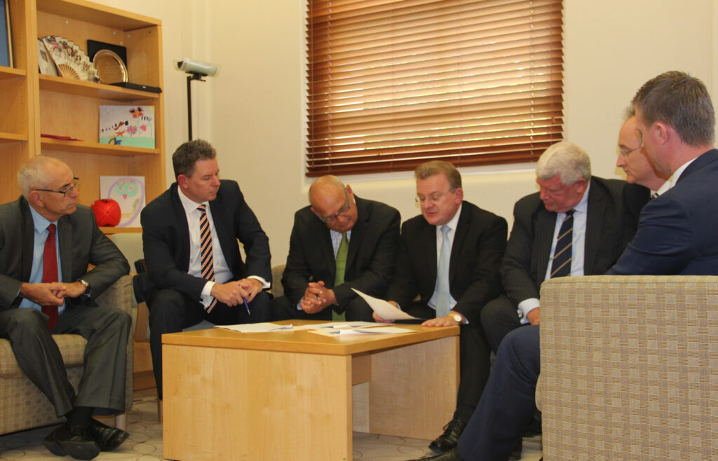 Signatories to the data sharing agreement with Minister Billson