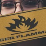 Lawyer with flammable warning sign