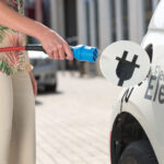 Plugging in an electric car to charge